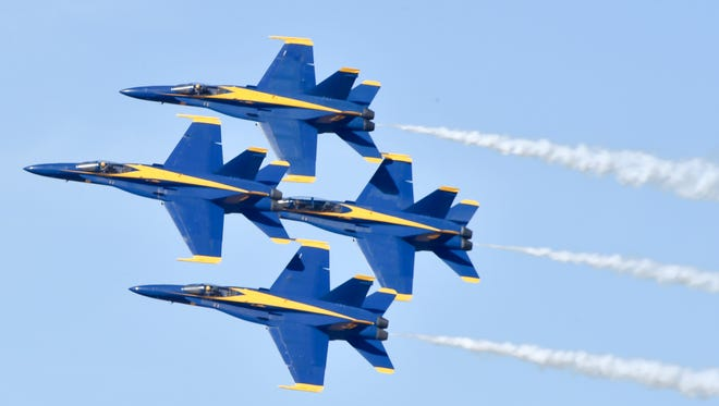 The U.S. Navy Blue Angels fly in Diamond Formation maneuvers in front of the crowd at the NAF El Centro Air Show in California in March.