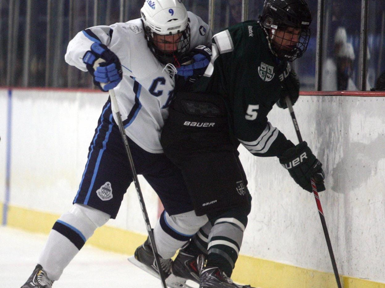 Billy Antonides, #9 CBA, checks Andrew Petrillo, #5 Delbarton, into the boards during an ice hockey game Wednesday, January 8, 2014, at Jersey Shore Arena in Wall Township. Jody Somers / For The Asbury Park Press