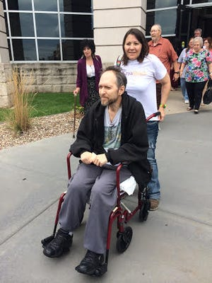 Benton Mackenzie and his wife, Loretta Mackenzie, leave the Scott County Courthouse after today's sentencing hearing.