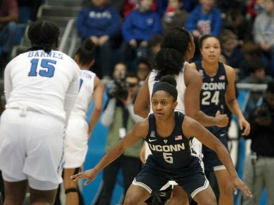 Connecticut guard Crystal Dangerfield (5) defends against Memphis' Taylor Barnes (15) in the second half of an NCAA college basketball game Wednesday, Jan. 24, 2018, in Memphis, Tenn. (AP Photo/Karen Pulfer Focht)