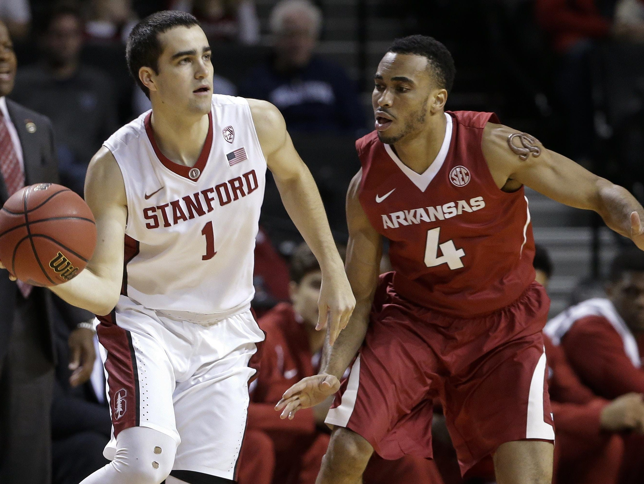 Stanford's Christian Sanders (1) passes away from Arkansas' Jabril Durham (4) during the first half in the consolation round of the NIT Season Tip-Off tournament on Friday in New York.