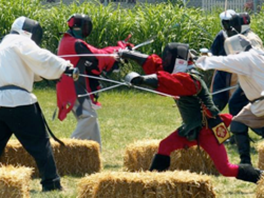 SCA reenactors fence at a past event. They will be performing at the RW Monk Gardens' Medieval Adventure fundraiser this weekend.