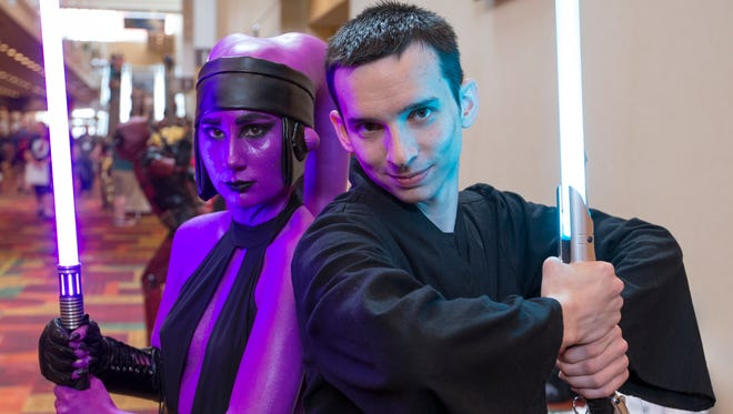 Judy Vidal (left), Milwaukee, playing the part of Darth Vanitas, a dark jedi character she created, poses with Dylan Howard, as her apprentice, at Gen Con 50, Indiana Convention Center, Indianapolis, Thursday, August 17, 2017. The event for gamers and enthusiasts, runs through the weekend.