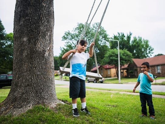 May 19, 2017 - Anderson Maldonado, 5, plays on a swing