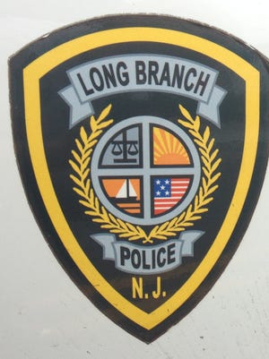A former Long Branch police officer was stabbed four times in the stomach and the face during a fight at the Arena Bar Saturday.