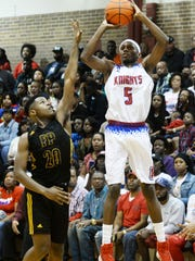 Woodlawn's Jalen Brooks tries to get the ball in the