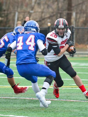 North Quincy's Thomas Murray is met by Quincy's Matt Kelly during the Thanksgiving Day game on Nov. 28, 2019.
