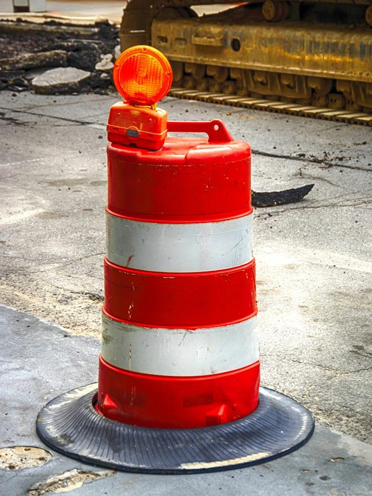 Orange and White roadway safety cone