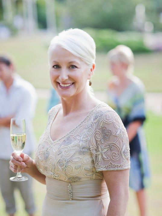 Mature woman drinking champagne