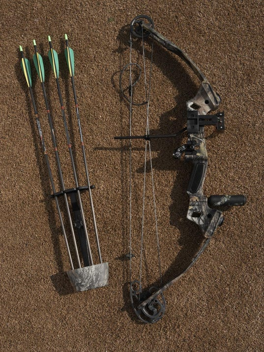 Hunting bow and arrows, overhead view