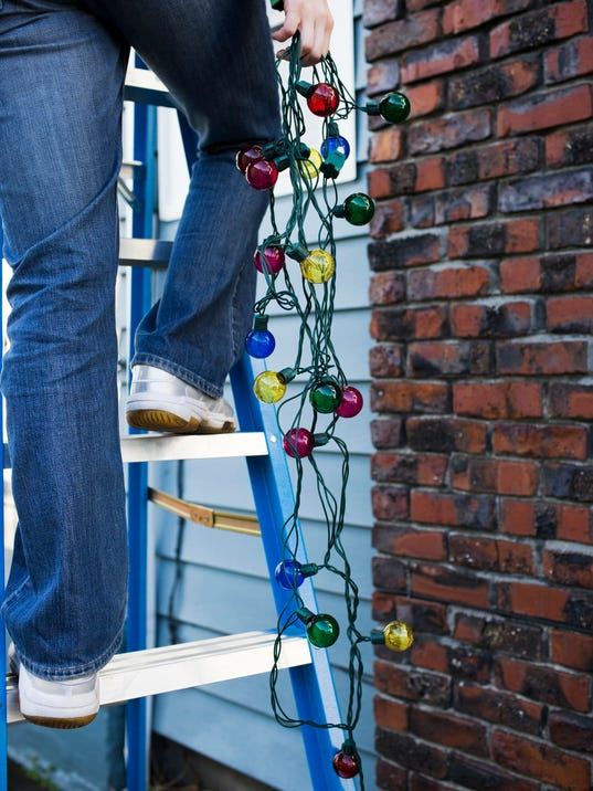Christmas Lights Hanging from Ladder Outside Chimney, Copy Space