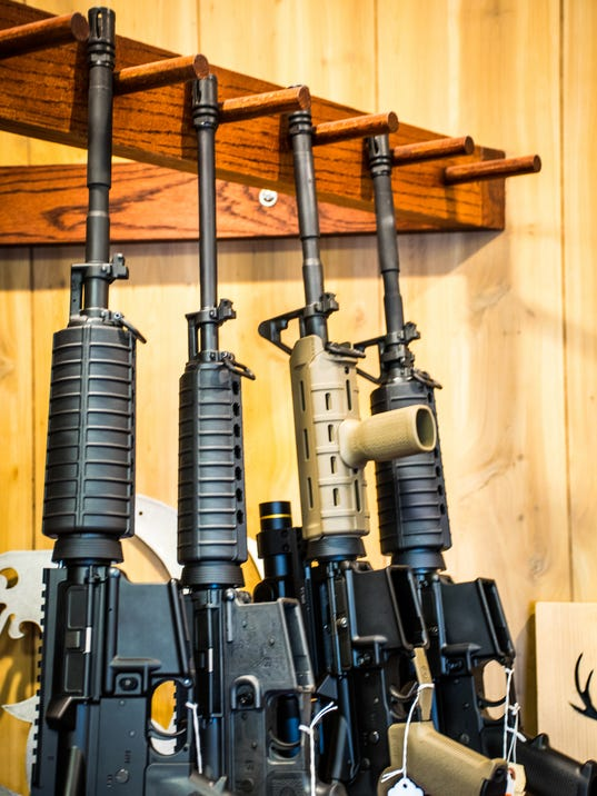 Color image of military grade assault rifles easily purchased and for sale in America