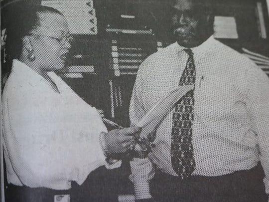 New Union County School Board member William Greenwell was sworn in by Union County Board secretary Zelinda Fellows at a school board meeting in 2000.