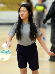 Hoa Le returns a ball while playing pickleball on Wednesday,