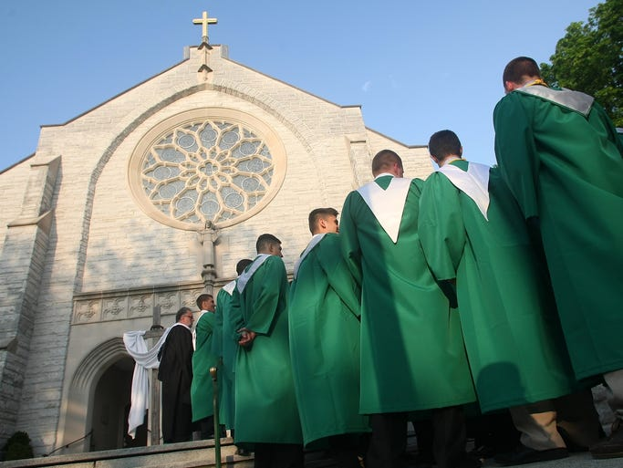St. Joseph of Metuchen High School graduates enter St. Francis of Assisi Cathedral for their commencement, Thursday, May 22, 2014, in Metuchen, NJ.