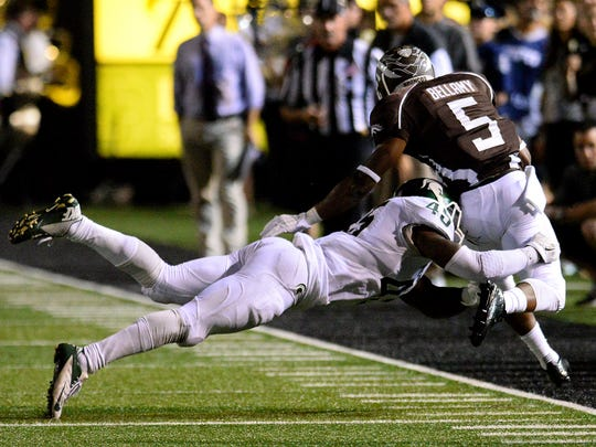 Michigan State linebacker Darien Harris forces Western Michigan's LeVante Bellamy (5) out of bounds in the third quarter of the Spartans' 37-24 victory over the Broncos in 2015.
