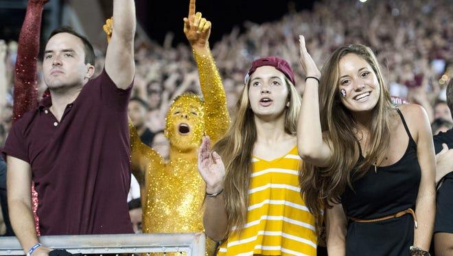 FSU fans celebrate their win over Notre Dame Saturday night.