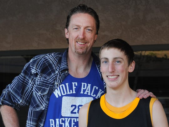 Caleb Wood stands with his father Dave Wood in 2013.