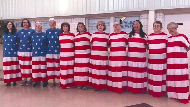 The Take Off Pounds Sensibly chapters from Burkburnett and Wichita Falls recited the Pledge of Allegiance in their flag dresses for the Fourth of July. From left are Becky Swaim, Renee Bryant, Jo Breedlove, Vernie Nordstrom, Julie Stiver, Sheila Barrington, Joanne Silverman, Ruby Jean Turner, Cora Norris, Corine Ledbetter and Louise Adams. For more information about TOPS, go to www.tops.org.