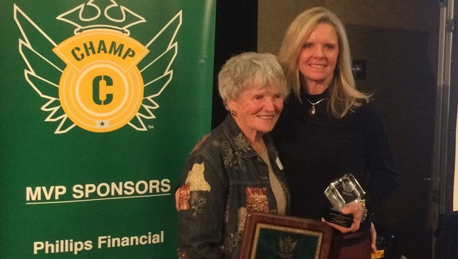 Evelyn Hoeven Arterburn, left, and her daughter, Laura Ecton, won the Keli McGregor and Sonny Lubick awards, respectively, for 2016 at the annual CHAMP Breakfast of Champions on Wednesday.