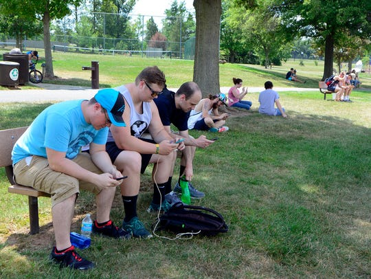 Pokeman Go players gather at Cousler Park in Manchester