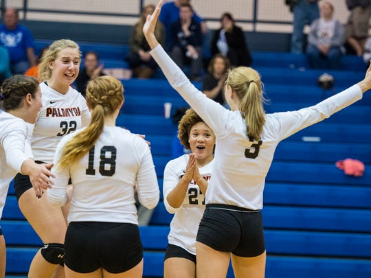 Palmyra's Memphis Martin, Maggie Black (32) Kirstin West, Melanie Sheaffer (3) and Rachel Hutchinson (18) celebrate after winning the final point of the match as Palmyra defeated Lower Dauphin in three sets in the quarterfinals of the District 3 Class 3A volleyball tournament on Tuesday, November 1, 2016.