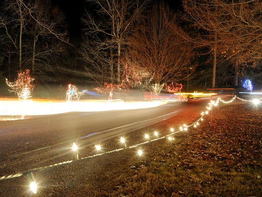 Cars form streaks of light from their headlights as