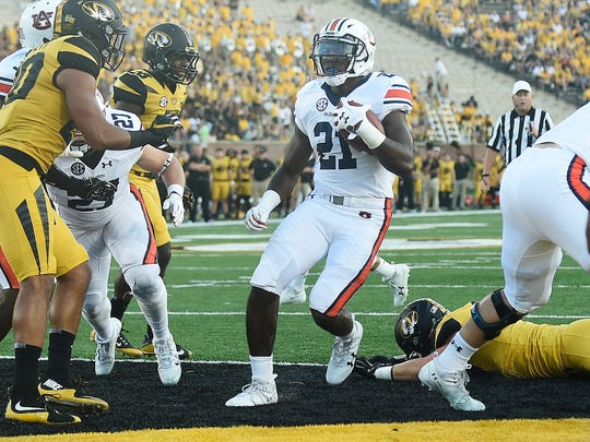 Auburn running back Kerryon Johnson (21) scores Auburn's first touchdown of the game.