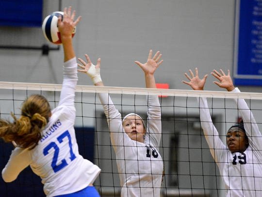 West York's Trilby Kite, center, and Tesia Thomas attempt to block an attempted kill by Tori Schrader of Lower Dauphin during the District 3 girls' volleyball semifinal, Thursday, Nov. 2, 2017. John A. Pavoncello photo
