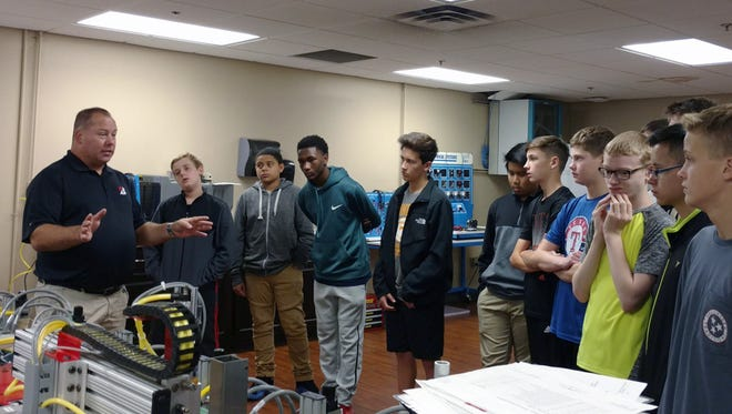 Brad Fannin of Bridgestone talks with students from Rockvale Middle School during a tour in October.