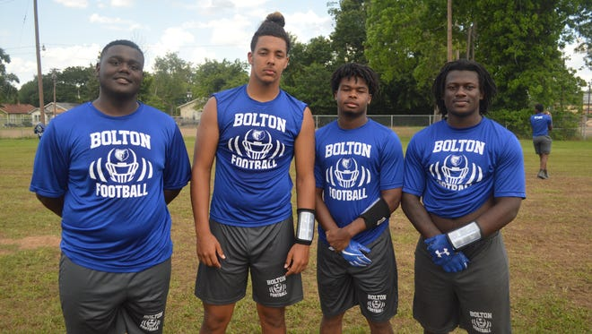 Bolton is hoping earn its first winning season since 2001 under players such as (from left): Tyriq Drumgo, Eric Whelan, Jermaine Hammond and Ken Molette.