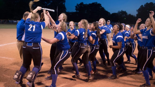 The Memorial softball team collects their 3A Regional #16 plaque after beating Vincennes Lincoln 2-1 in 12 innings at Nativity Field in Evansville Tuesday evening.