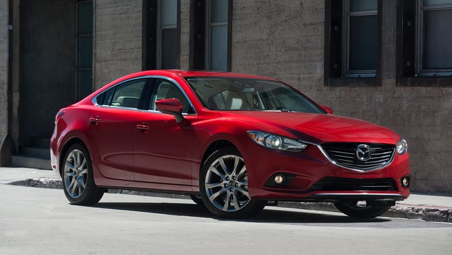 The 2014 Mazda6 is a four-door sedan that looks like it was styled by Italian artisans.