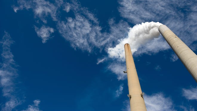 """The smoke stacks at American Electric Power's (AEP) Mountaineer coal power plant in New Haven, West Virginia, October 30, 2009. In cooperation with AEP, the French company Alstom unveiled the world's largest carbon capture facility at a coal plant, so called """"clean coal,"""" which will store around 100,000 metric tonnes of carbon dioxide a year 2.1 kilometers (7,200 feet) underground."""