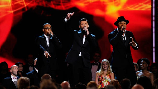 6/8/14 9:21:07 PM -- New York, NY, U.S.A  -- T.I., left, Hugh Jackman and LL Cool J perform  during the 68th annual Tony Awards from Radio City Music Hall --    Photo by Robert Deutsch, USA TODAY Staff ORG XMIT:  RD 131205 2014 TONYS 6/8/2014 [Via MerlinFTP Drop]