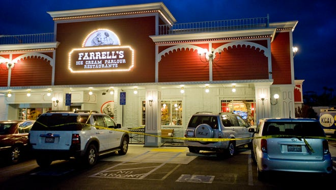 Police investigate a fatal parking lot accident in which a man in his 70s driving an SUV lost control and drove into a line of people outside Farrell's Ice Cream Parlour in Buena Park, Calif., on April 25, 2014.