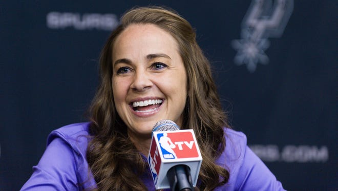 WNBA star Becky Hammon takes questions from the media at the San Antonio Spurs practice facility after being introduced as an assistant coach with the team on Tuesday.