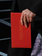 The envelope in Warren Beatty's hand clearly says,