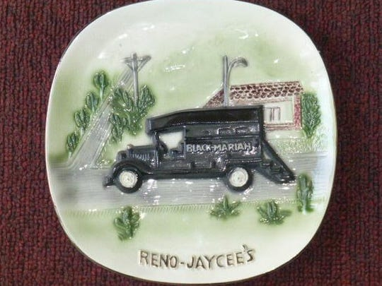 A ceramic plate featuring the Black Mariah, sold for charity in the 1970s.