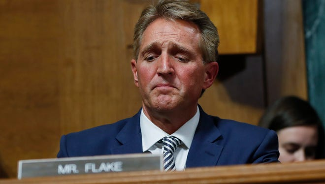 Sen. Jeff Flake, R-Ariz., after speaking during the Senate Judiciary Committee hearing about an investigation, Friday, Sept. 28, 2018 on Capitol Hill in Washington. After a flurry of last-minute negotiations, the Senate Judiciary Committee advanced Brett Kavanaugh's nomination for the Supreme Court after agreeing to a late call from Sen. Flake for a one week investigation into sexual assault allegation against the high court nominee.