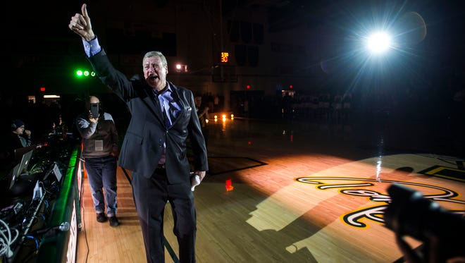 Tom Brennan, former UVM men's basketball coach, gives a thumbs up to the packed bleachers at Patrick Gymnasium  during a ceremony Monday night, Dec. 11, 2017, honoring the legendary coach by naming the court after him.