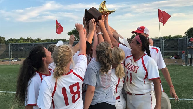 Albany players celebrate after outlasting Petrolia 21-17 for the Region I-2A softball championship Saturday.
