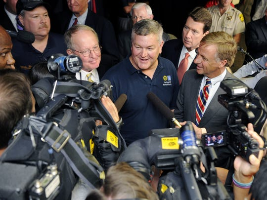 Plant Complex Manager Ken Knight, center, pictured with Sen. Lamar Alexander, left, and former-Gov. Bill Haslam, right, at a 2014 media event. Knight announced in December 2019 that he will step down at the plant.