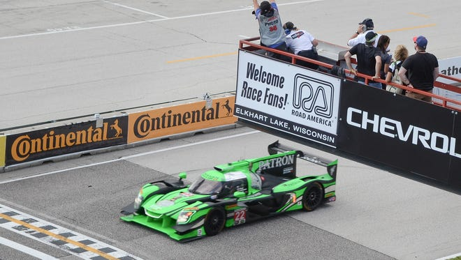 Pipo Derani takes the checkered flag as the winner of the 2017 Continental Tire Road Race Showcase at Road America.