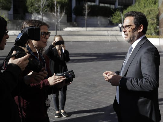 Marc S. Harris, lawyer for actress Lori Loughlin talks to the media outside the federal courthouse for Wednesday, March 13, 2019, in Los Angeles.
