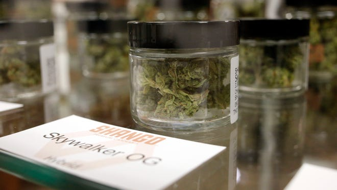 In this Sept. 30, 2015, file photo, Cannabis is packaged and ready for sale in Shango Premium Cannabis, in Portland, Ore.