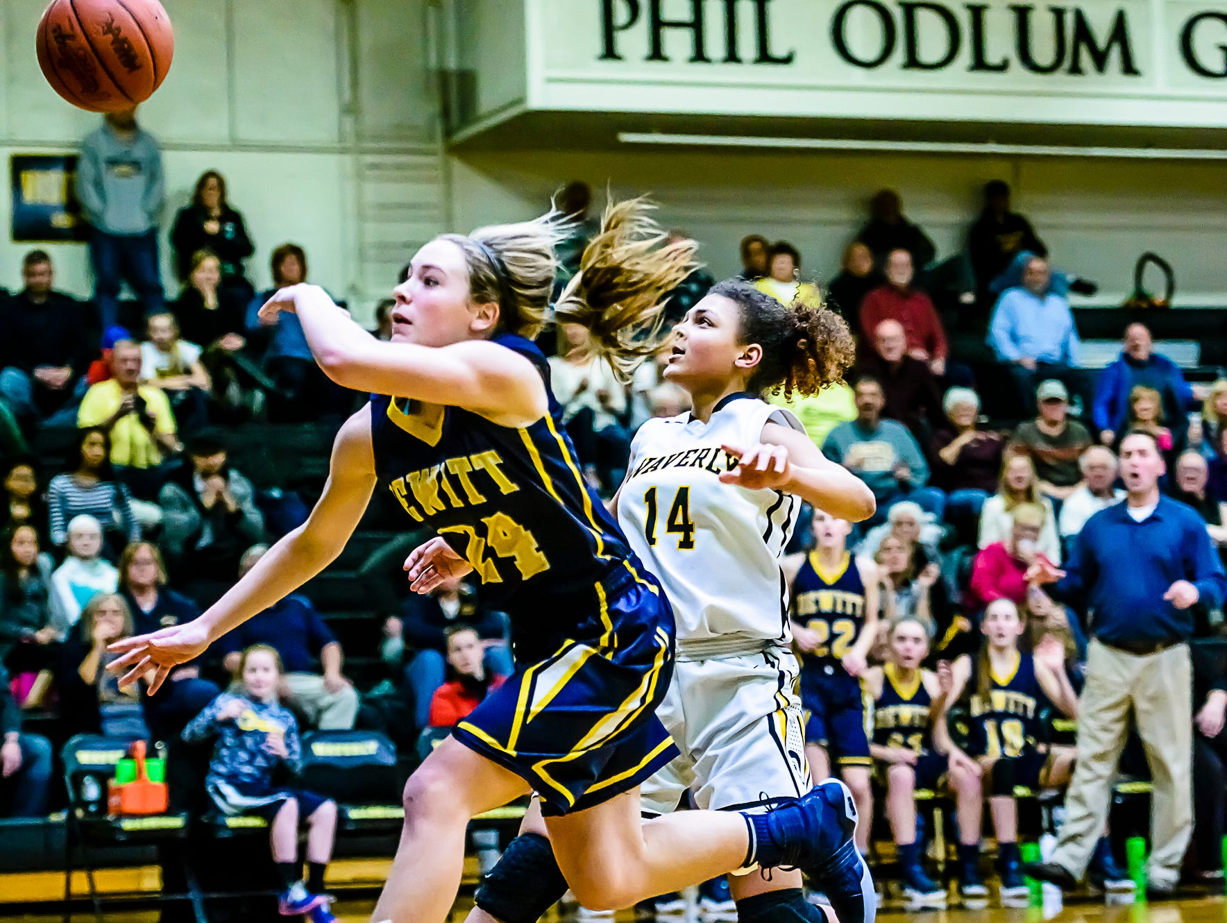 Priscilla Trainor ,14, of Waverly intentionally fouls Annie McIntosh ,24, of DeWitt with 6.4 seconds remaining in their game and DeWitt leading 53-50 Friday February 10, 2017 in Delta Township. The Intentional foul gave DeWitt two freethrows and possession of the ball to seal the win. KEVIN W. FOWLER PHOTO