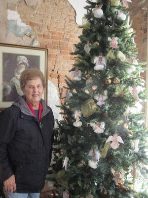Alice Russell of the Mineral County Historic Foundation is shown with the angel tree which will be part of the Christmas tour of the Carskadon Mansion. The angels from the Bradford Collection were donated to the mansion by the family of the late Eloise Sherwood.  Tribune photos by Ronda Wertman