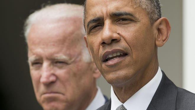 FILE - In this June 25, 2015 file photo, President Barack Obama, accompanied by Vice President Joe Biden, speaks in the Rose Garden of the White House. (AP Photo/Pablo Martinez Monsivais, File)