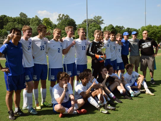 Robert E. Lee's boys soccer team poses with the championship
